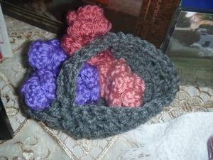 crocheted flowers in a basket
