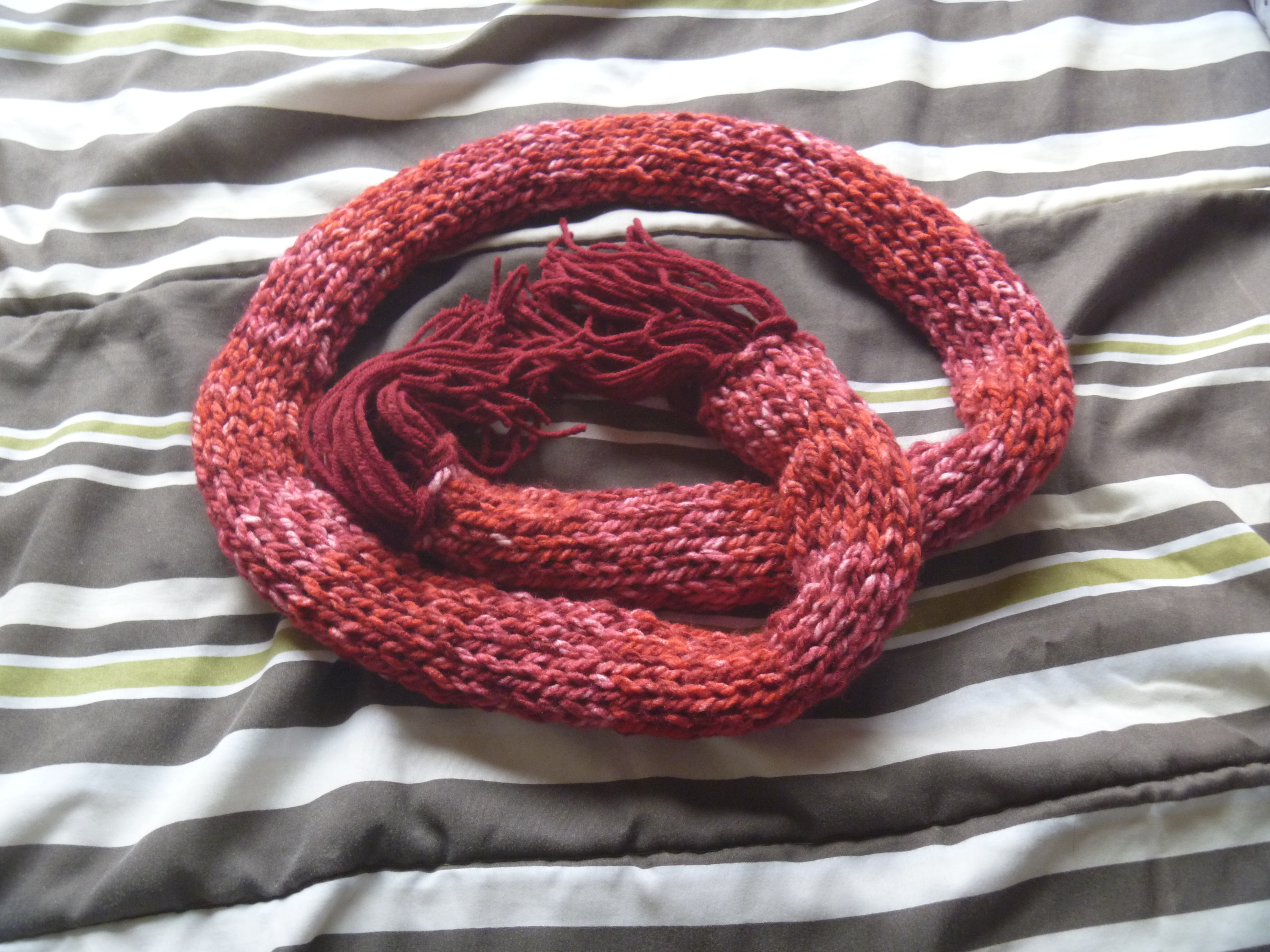 curled up finished red fringed scarf