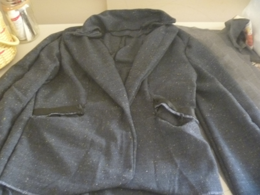 unlined jacket with messy pocket parts