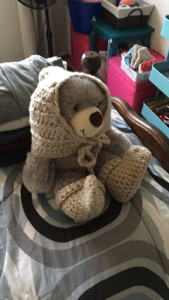 crochet hat and booties on teddy bear