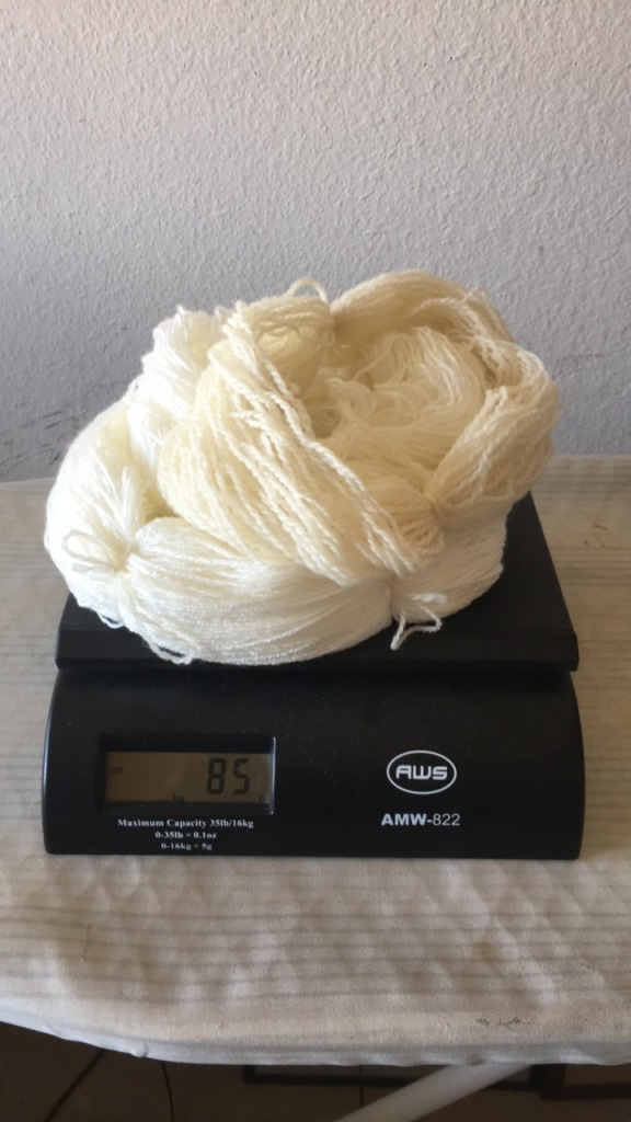 yarn being weighed