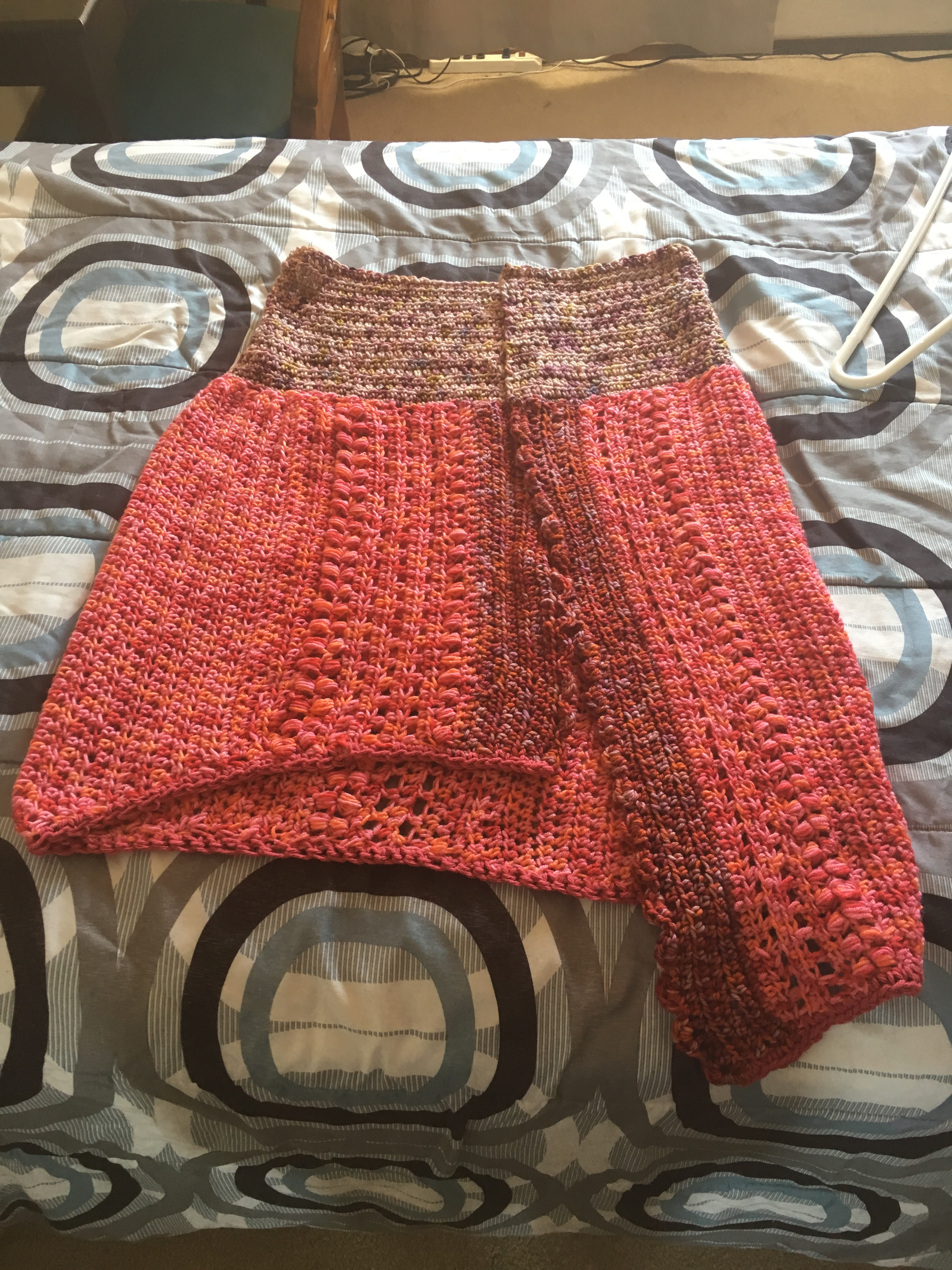 finished shawl with red and pink yarn