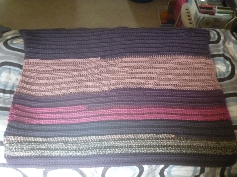 purple and pink striped crochet blanket
