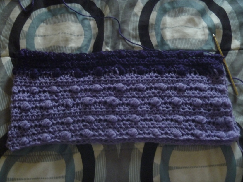 top or shawl made with purple yarn
