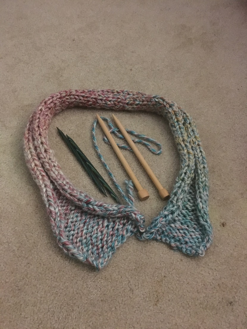 finished scarf part one with knitting needles