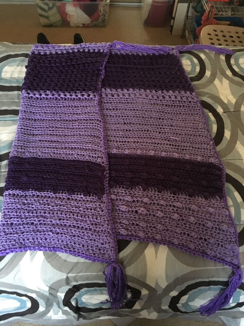 striped purple wrap or mini-blanket, one side folded over
