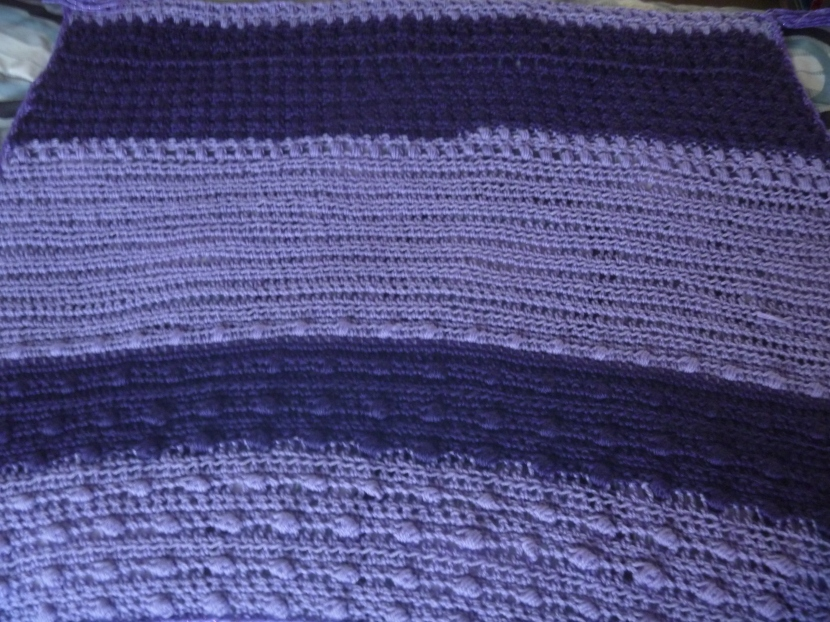 close up of striped purple wrap or mini-blanket