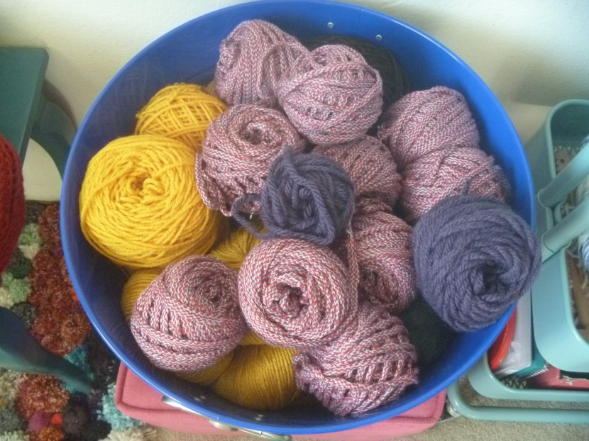 yarn from one rug taken apart and turned into balls