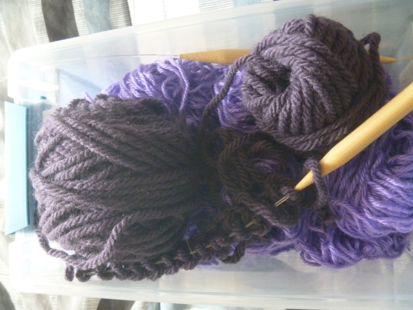 various purple yarns to be knit