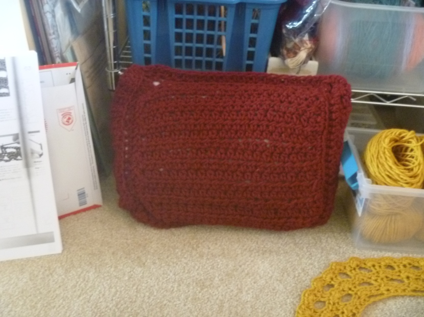 finished red crochet pillow sans decoration