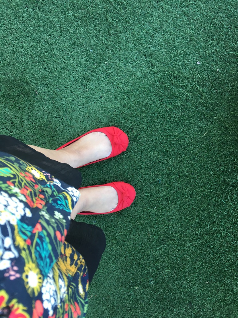 picture taken of my red shoes on green grass