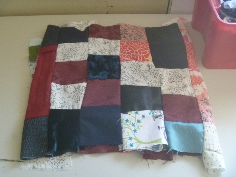 folded up middle of simple quilt top