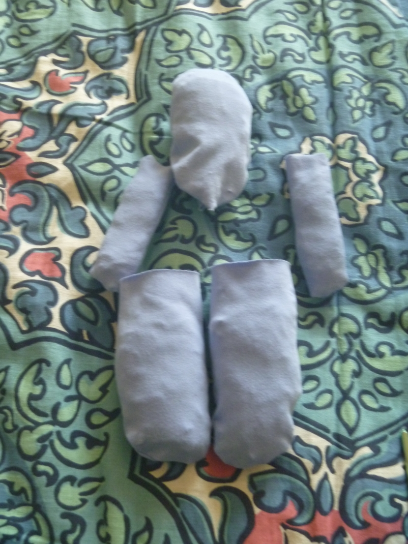 partially stuffed doll head, and stuffed arms and legs