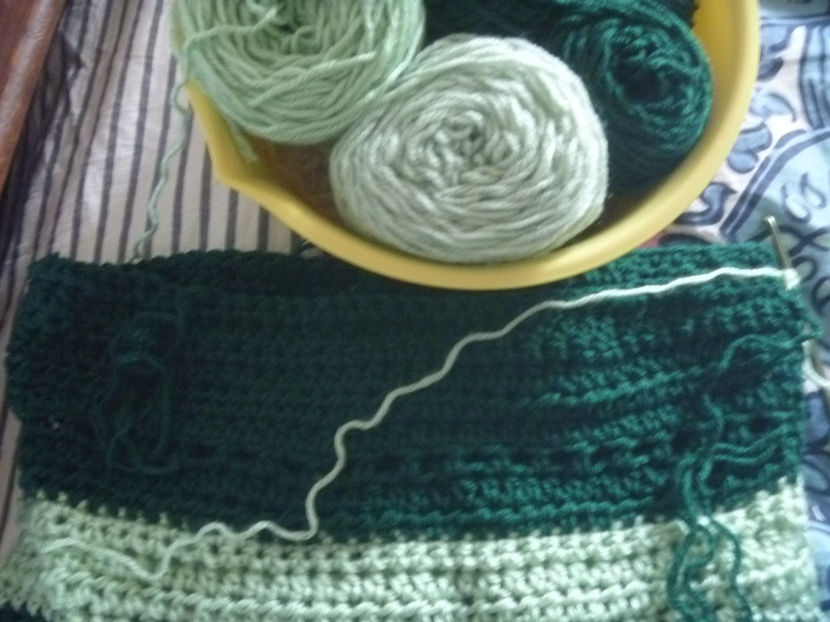 part of green striped blanket