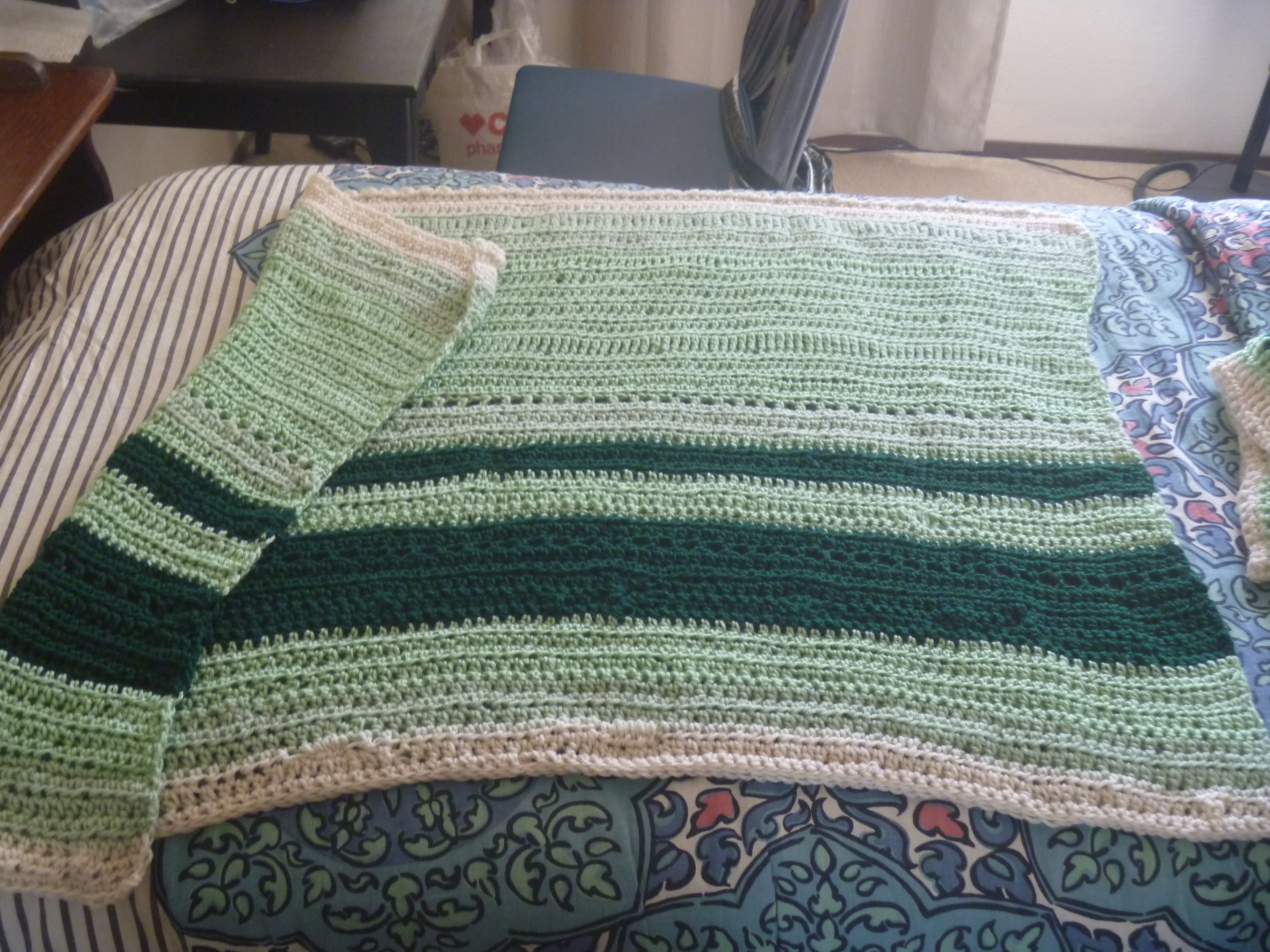small green and white striped blanket
