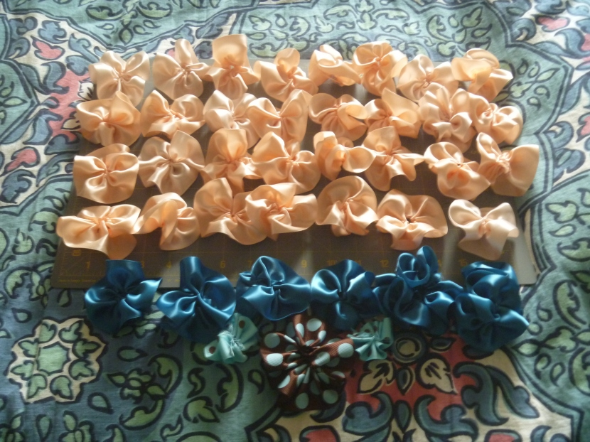 flowers made from blue, peach and brown ribbon