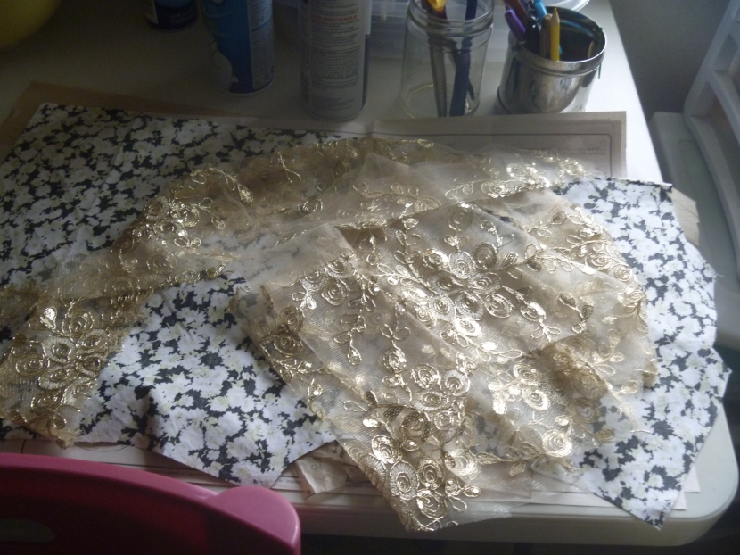 sleeves and collar and hem of lace jacket, plus another top in pieces underneathe