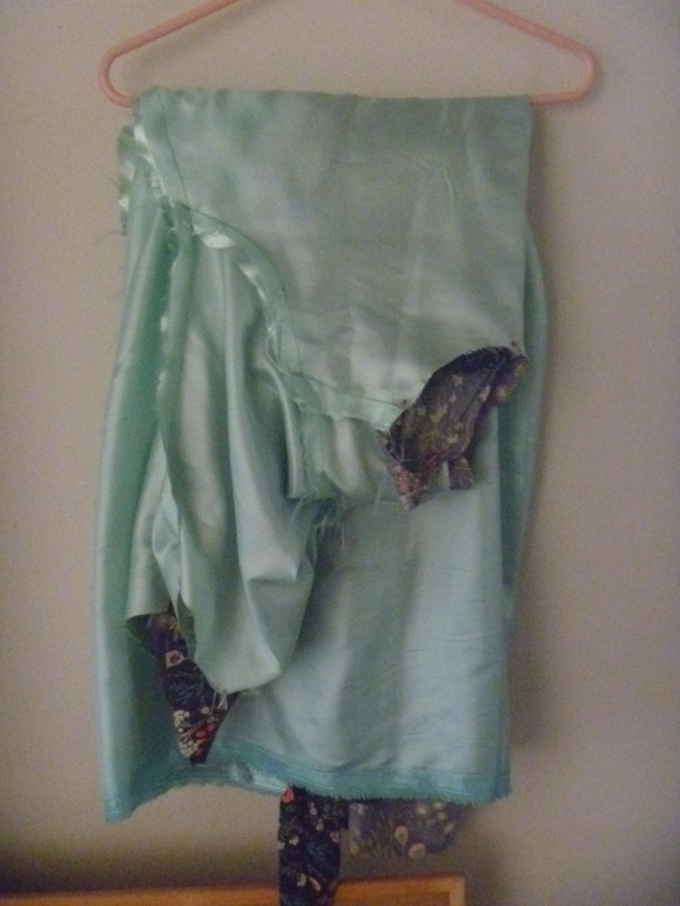 dress hanging on a hanger with the inside lining on the outside