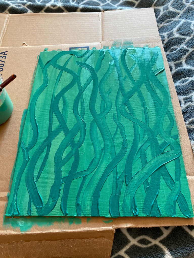 Green swirls on green paint