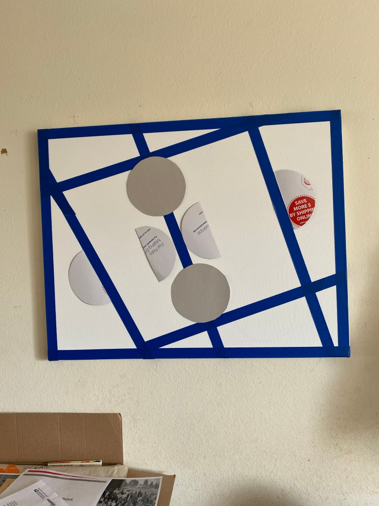 Canvas with tape and cut out circles and half circles