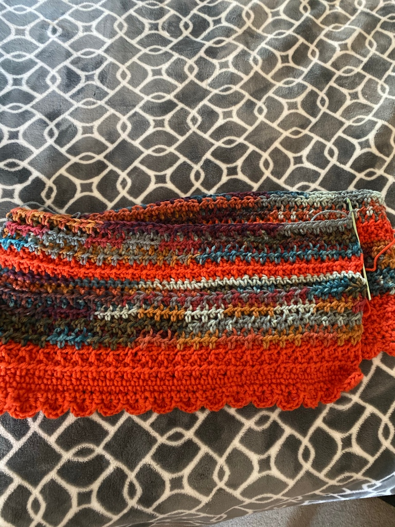 Orange and variegated striped shawl