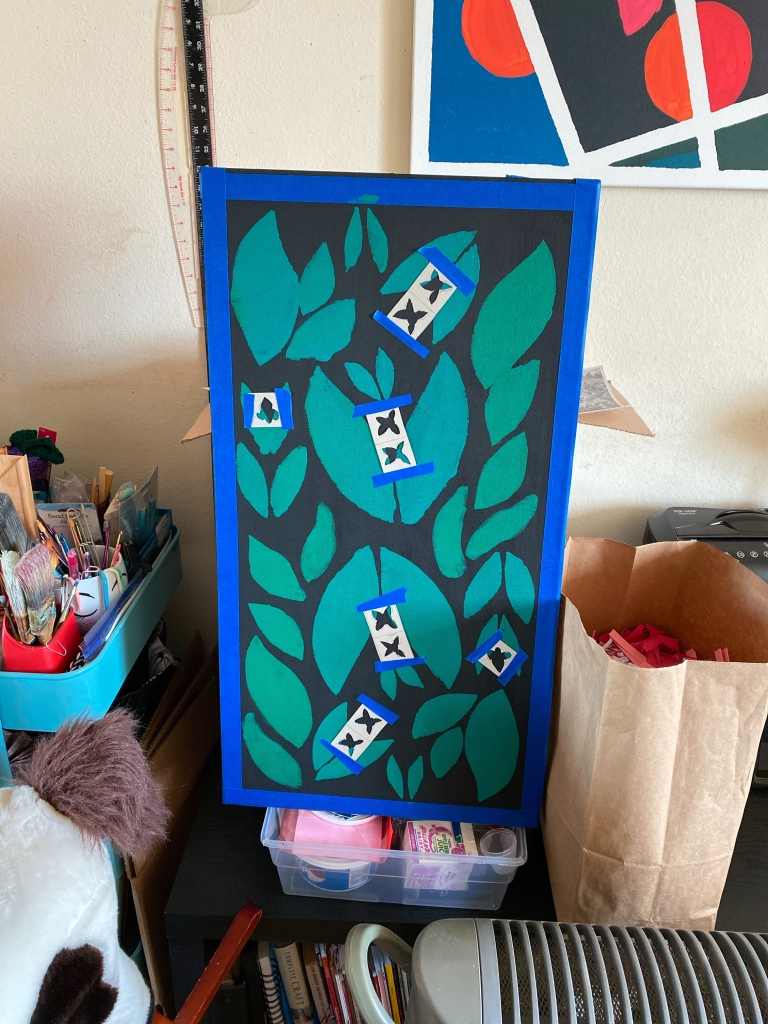 Painting with stencils taped over it